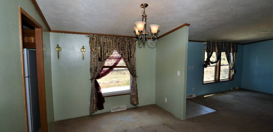 Rancher with Views, sitting on more than 7 Acres.